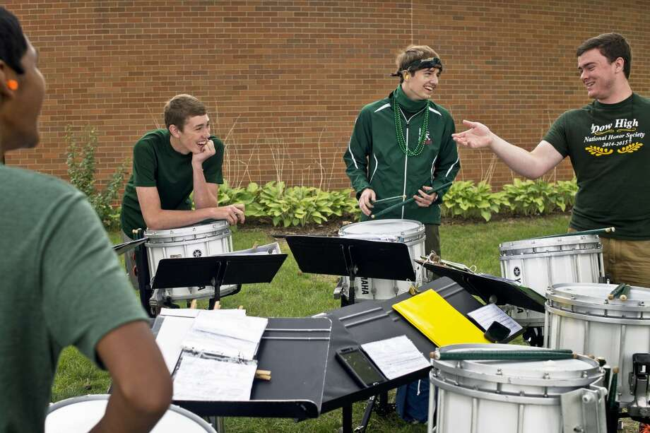 In this Daily News file photo, senior Mathew Rightor, 17, center, and other students share a laugh while taking a break during practice. Rightor has received a full scholarship to attend Michigan State University this fall.