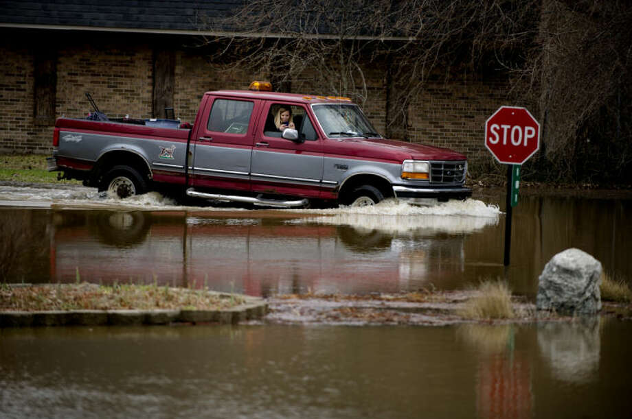 A truck as he drives through flood waters in Sanford in this Daily News file photo. Flooding is always a possibility in the Midland County area during the spring season.