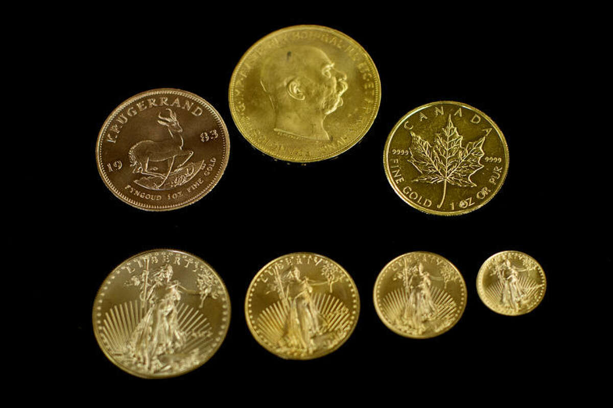 NICK KING   nking@mdn.netRon Rittenburg has gold in various forms at his Collector's World shop including American Gold Eagle coins, bottom row, and from top left, the South African Krugerrand, the Austria 100 Corona and the Canadian Maple Leaf.