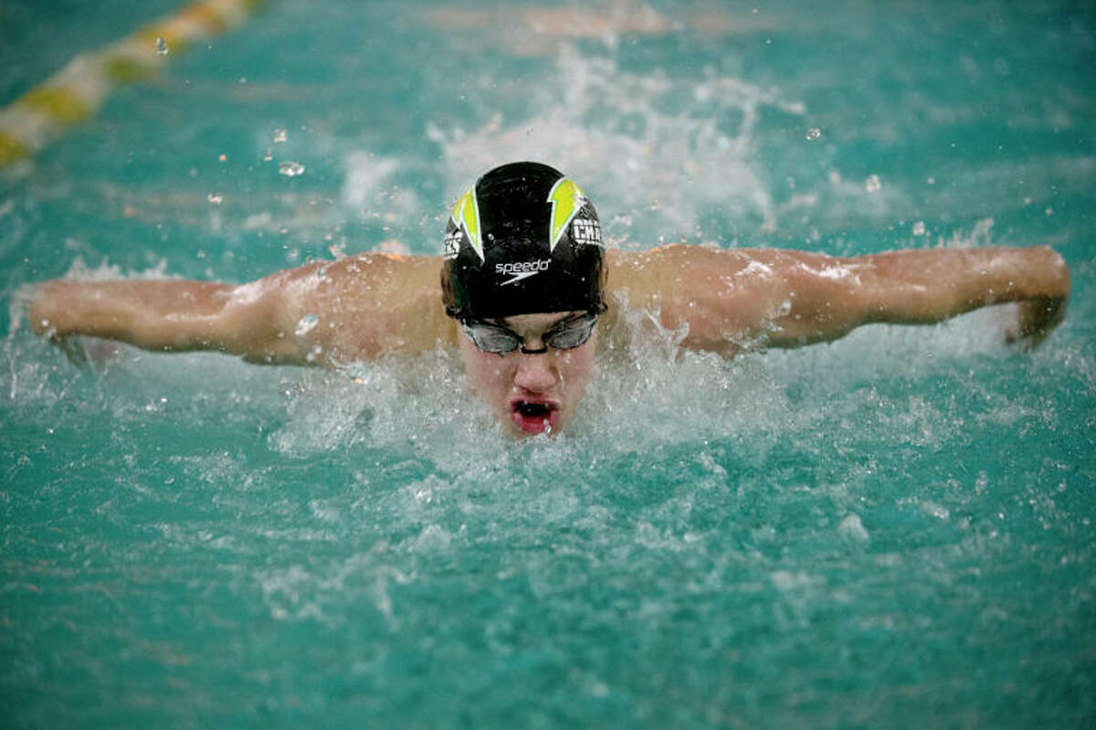 SEAN PROCTOR | sproctor@mdn.netDow's Nehemiah Mork competes in the second heat of the 100 Yard Butterfly against Birmingham Groves Tuesday night at Dow High School. Dow defeated Birmingham Groves 105-78.