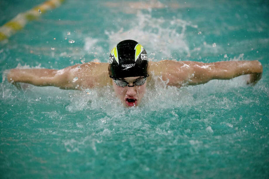 SEAN PROCTOR | sproctor@mdn.netDow's Nehemiah Mork competes in the second heat of the 100 Yard Butterfly against Birmingham Groves Tuesday night at Dow High School. Dow defeated Birmingham Groves 105-78. Photo: Sean Proctor / (c) Sean Proctor (c) Midland Daily News
