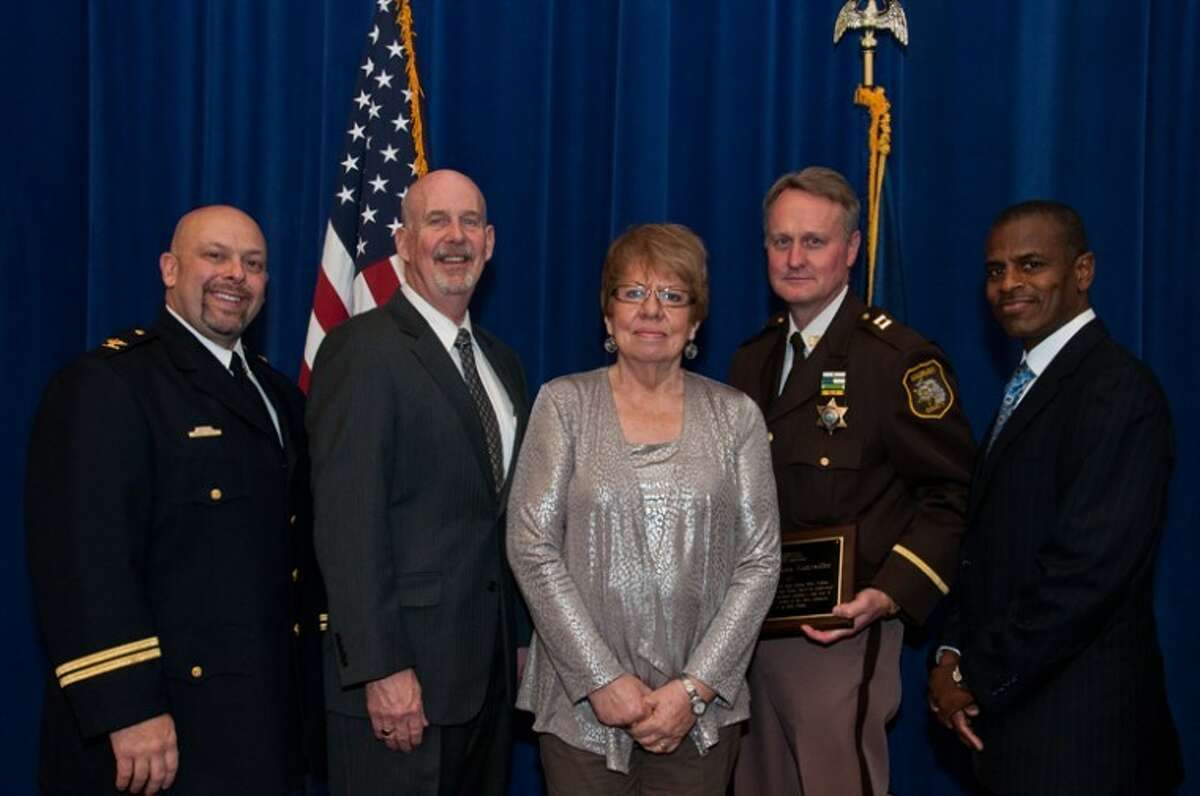 From left to right: Mike Wiltse, director; Robert (Bob) Stevenson, executive director, Michigan Association of Chiefs of Police (MACP); Jill Gallihugh; Capt. William Gutzwiller, Saginaw County Sheriff's Office; and Galvann Smith, academy coordinator.