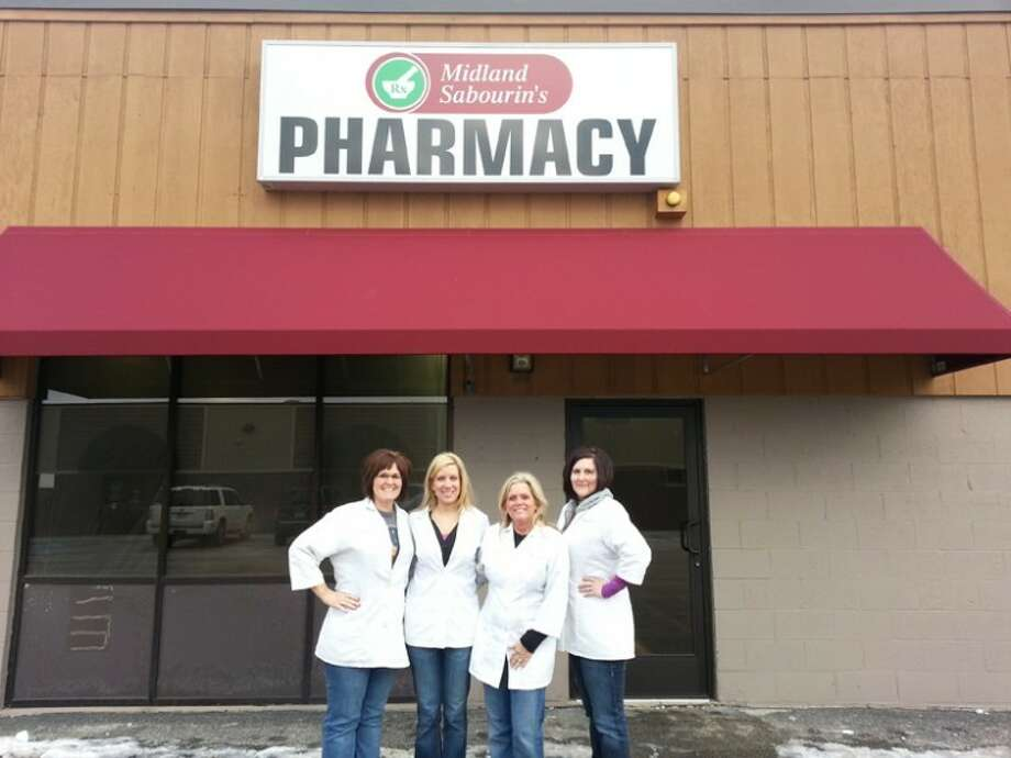 Photo providedSabourin's Pharmacy staff gathers in front of their new location at 314  W.  Wackerly St.  From left are co-owners Jennifer Wysopal, Jennifer Christensen and Cindy Adamowski along with pharmacy technician Laura Behmlander.