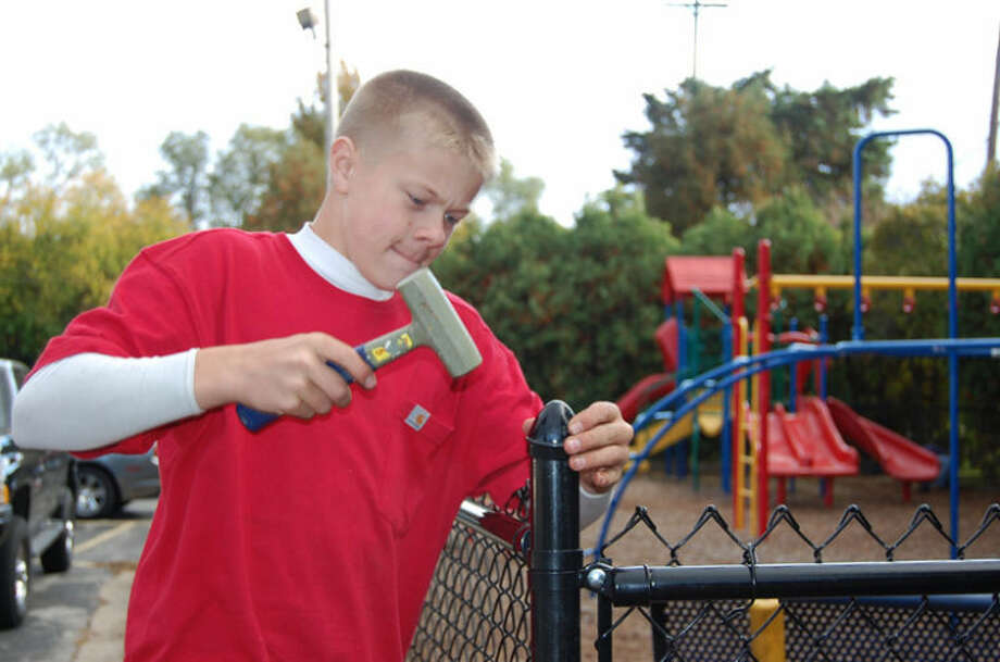Photo providedNicholas Berchert, 13, of Midland, works on the fence.