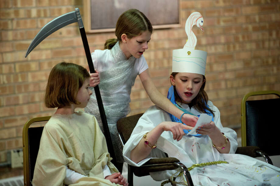 "From left, Lydia Webb, 10, her sister Madeline, 11, and Hannah Woehrle, 10, act out a scene during the Flying Pig Theatre Academy's production of ""The Gift of the Nile"" Wednesday at Creative 360. The class is for students 7-12 and the production was written by student Madeline Webb, 11, and costumes and sets were designed by the students. Photo: Nick King/Midland  Daily News / Midland Daily News"