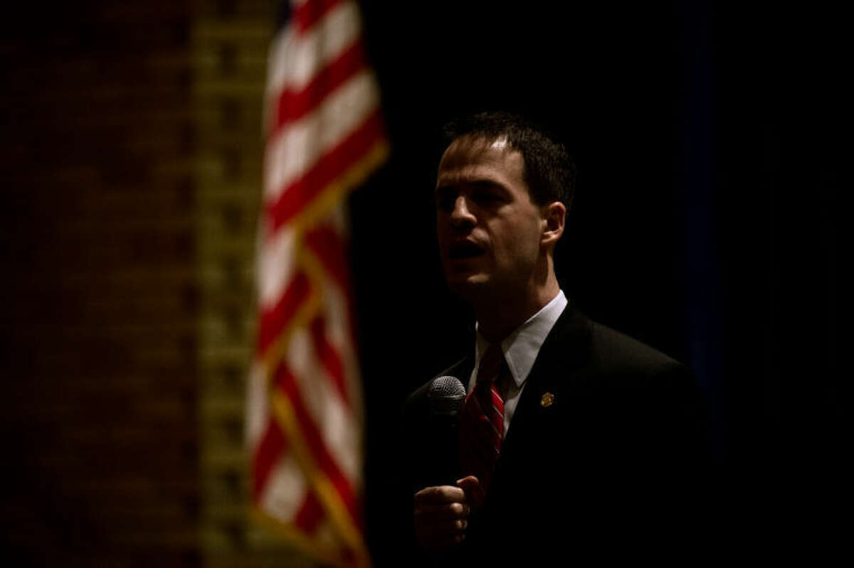 SEAN PROCTOR   sproctor@mdn.net State Representative Kevin Cotter talks with students and answers questions, ranging from how much he makes, his stance on gun control and if he prefers the University of Michigan or Michigan State University sports Friday afternoon at Coleman High School following the recognition of the Veterans of Foreign Wars Voice of Democracy and Patriot Pen essay contests.