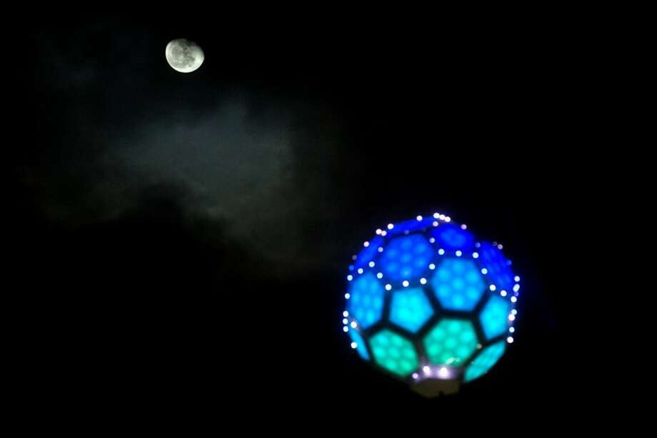 SEAN PROCTOR | sproctor@mdn.netThe moon rises above the ball shortly before midnight on New Year's Eve during Midnight on Main. Photo: Sean Proctor