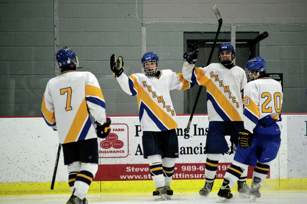 SEAN PROCTOR | sproctor@mdn.netMidland's Thomas Smith, center, celebrates a goal against Bay City with teammates Elliott Digison, and Jonathan Evans, right, as Ryan Singer, left, skates over to join Wednesday night at the Midland Civic Arena. Midland defeated Bay City 3-2.