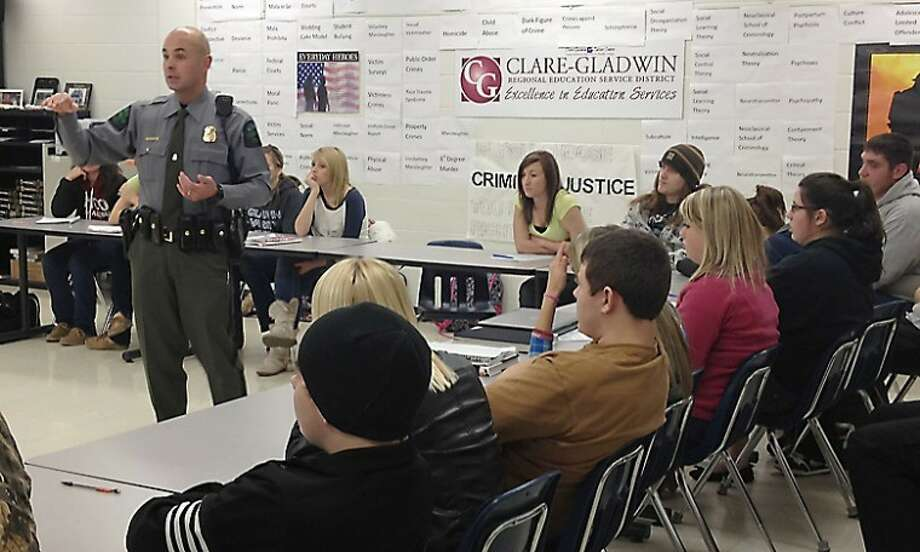 Photo providedClare County DNR Officer Jason Mccollugh recently spoke to the criminal justice students at the Clare-Gladwin Career Center's Career and Technical Education (CTE) program. Mccollugh discussed the roles and responsibilities of a DNR officer, as well as the education and training the career requires.
