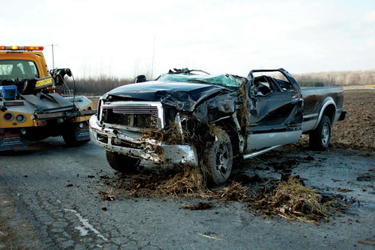 NEIL BLAKE | nblake@mdn.net A Ford pick-up truck sits in the road after an accident at the intersection of East Wackerly and Bay-Mid County Line Road on Friday.