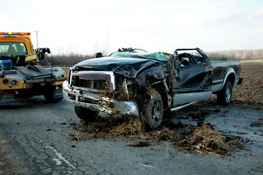 NEIL BLAKE | nblake@mdn.net A Ford pick-up truck sits in the road after an accident at the intersection of East Wackerly and Bay-Mid County Line Road on Friday. Photo: Neil Blake/Midland  Daily News / Midland Daily News