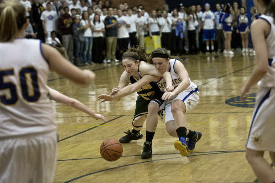 SEAN PROCTOR | sproctor@mdn.netMidland's Alyssa Westphal and Dow's Jenna Queary fight for possession of a loose ball Tuesday night at Midland High School. The Chargers beat the Chemics 50-45. Photo: Sean Proctor