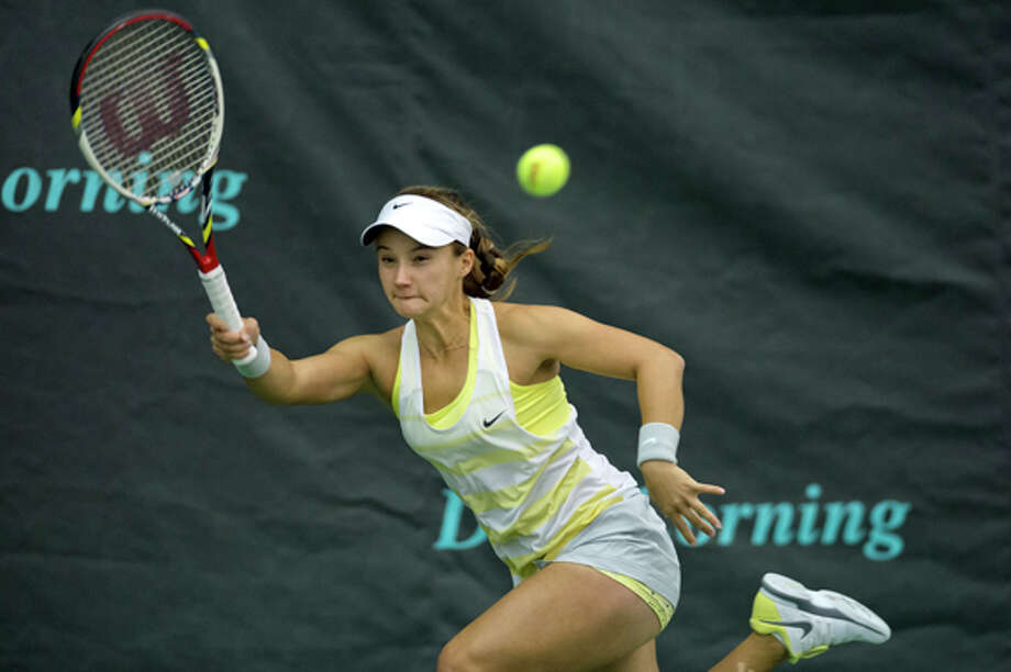 NICK KING | nking@mdn.net Lauren Davis, of the United States, hits the ball to Alla Kudryavtseva, of Russia, during their match at the Dow Corning Tennis Classic Friday at the Midland Community Tennis Center. Davis won the match in three sets. Photo: Nick King/Midland  Daily News / Midland Daily News