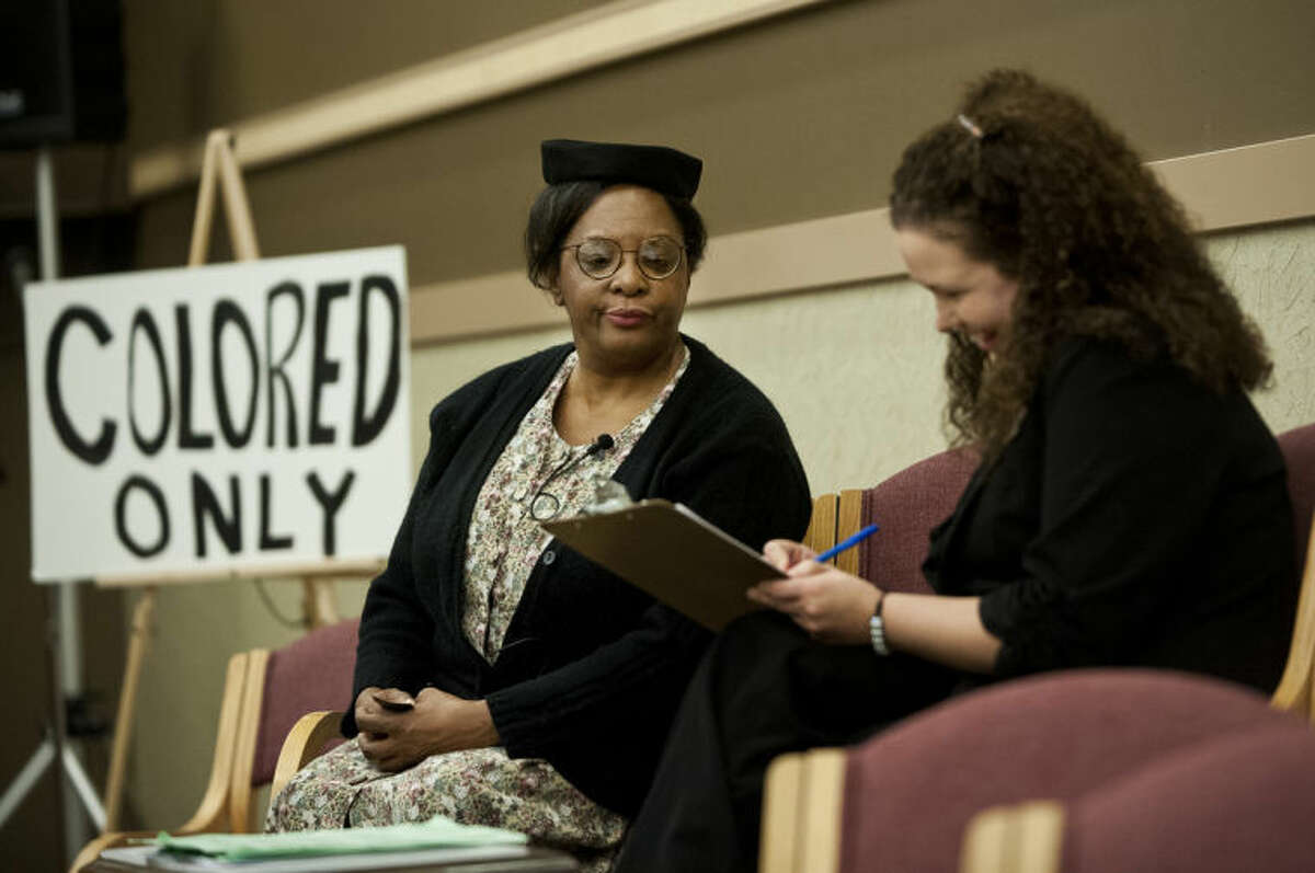 Zack Wittman | For the Daily NewsRosie Chapman performs a skit with Stephanie Lewandowki, who is taking a literacy test that was required for African Americans to vote during the days of the civil rights movement.
