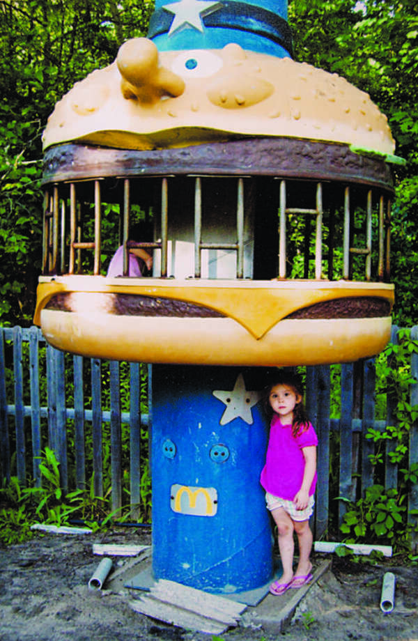 "Denny King's granddaughter Jadyn King, 9, stands in front of Denny's Chief Big Mac Climber. Denny recently sold the piece to the TV show ""American Restoration."" Photo: Photo Provided"