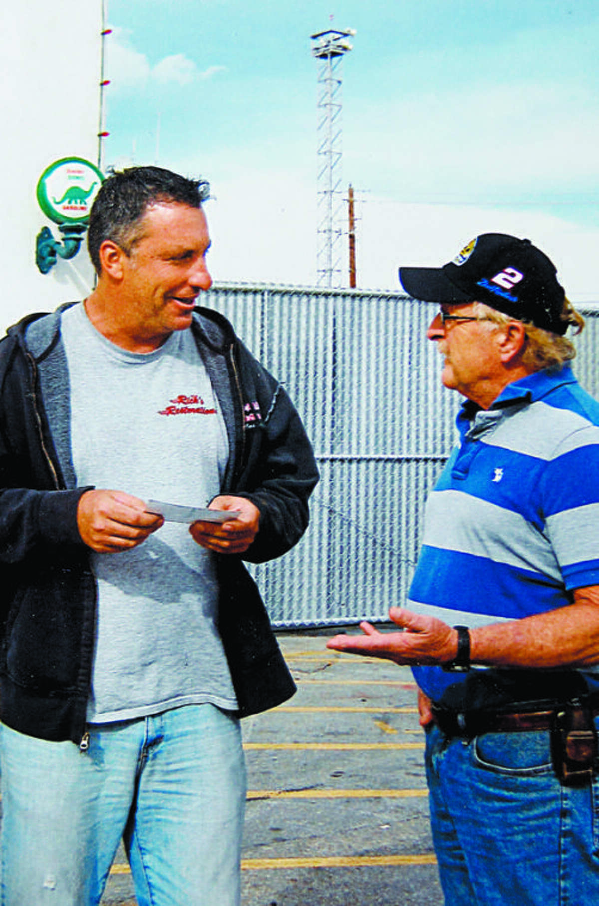 """Denny King, right, meets with Ron Dale, the brother of the host of the TV show """"American Restoration,"""" during a trip to Las Vegas. King stopped in to visit with Dale."""