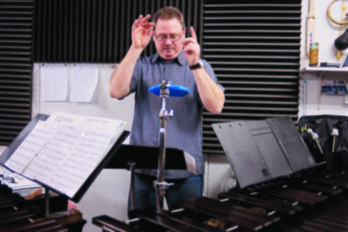 ZACK WITTMAN   for the Daily News Jim Fulkerson conducts the Junior Malletheads during practice at Fulkerson Music Studio on Monday evening. The Junior Malletheads will be playing a concert at Bullock Creek High School on February 9th, all proceeds will go towards new equipment for Bullock Creek's auditorium.