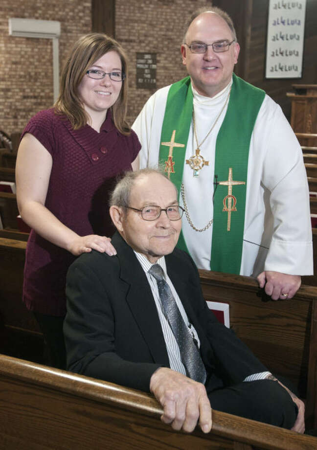 "Photo providedEmily Grant stands with Christ Evangelical Lutheran Church Pastor David Mielke. They saved the life of Ernest ""Bud"" Schmeige, seated in front, during a November service at the church by calling 911 and beginning cardiopulmonary resuscitation, or CPR."