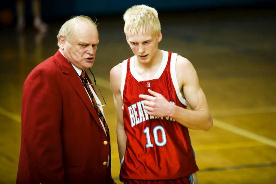 NEIL BLAKE | photo@mdn.netBeaverton coach Roy Johnston speaks with a player in this file photo. Johnston earned his 700t career victory Tuesday night.