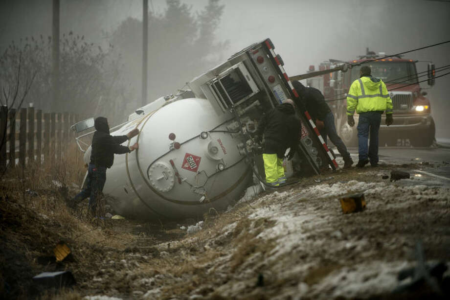 NEIL BLAKE | nblake@mdn.net This crash involving a liquid propane gas tanker truck on South Eight Mile near Stewart Road on Jan. 29 forced the evacuation of residents within one-half mile of the crash. Check out other photos from the week of Jan. 28 by clicking on the yellow gallery link. Photo: Neil Blake/Midland  Daily News