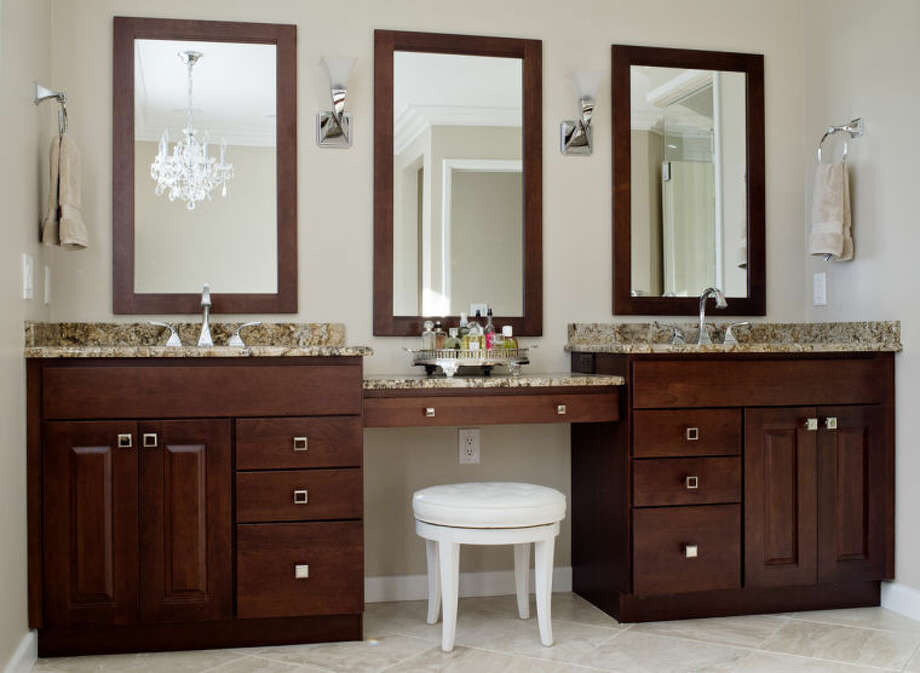 NICK KING | nking@mdn.netThis custom Midland bathroom features his and her sinks. Designed by Julie owner Julie Ratcliffe works with her clients to come up with a plan, style and function specific to the their needs. Photo: Nick King/Midland  Daily News