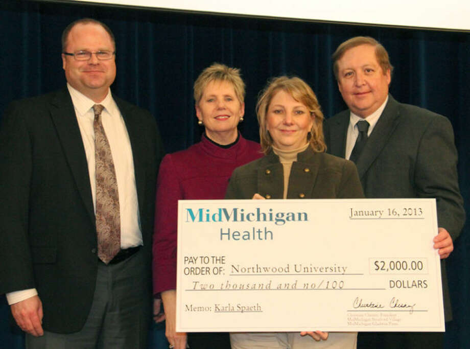Photo providedFrom left are Brian Buckingham, Chris Chesny, Karla Spaeth and Bob Berg during the surprise $2,000 scholarship presentation in honor of Spaeth.