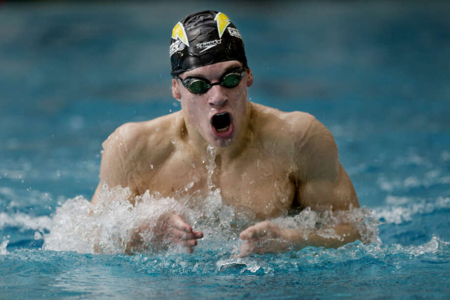 NEIL BLAKE | nblake@mdn.netDow's Ben Martin swims in the 200 yard individual medley at the Tri City Championship at Saginaw Valley State University on Thursday. Martin won the event with a meet record of 1:54.60. Photo: Neil Blake/Midland  Daily News
