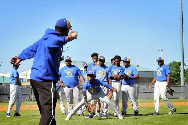 Ozen Panther baseball players prep for varsity head coach Waskyla Cullivan to begin a 'short hop' infield drill Monday at the Panthers' home field at Ozen High School in Beaumont. (Mike Tobias/The Enterprise)