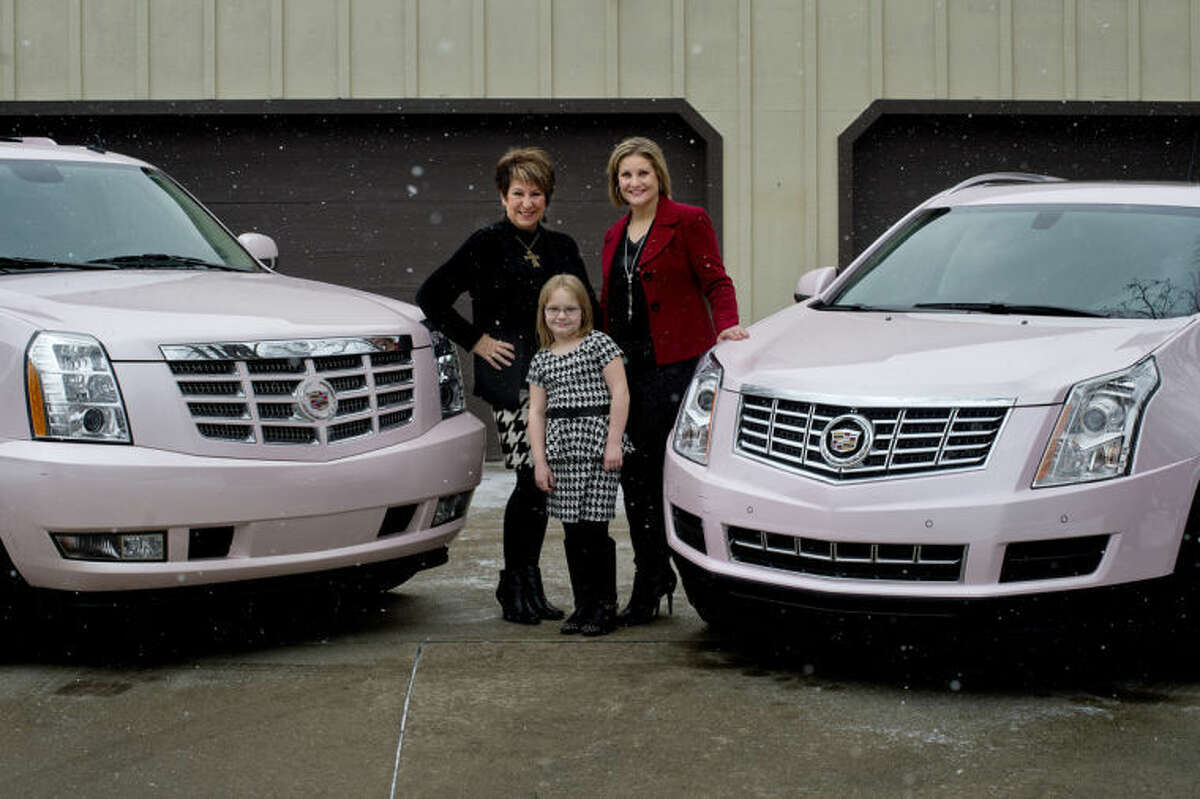 NICK KING   nking@mdn.netJudy Kawiecki, left, her grandaughter, Brynn Hansen, 6, and Brynn's mother and Judy's daughter, Lisa Hansen, pose by their pink Cadillacs which they earned the opportunity to drive based on their team production within Mary Kay.