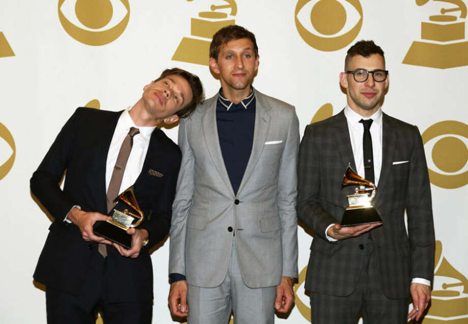 "Photo by Matt Sayles/Invision | APMembers of fun., from left, Nate Ruess, Andrew Dost, a graduate of Central Michigan University, and Jack Antonoff, pose backstage with the Song of the Year award for ""We Are Young"" at the 55th annual Grammy Awards. Photo: Matt Sayles"