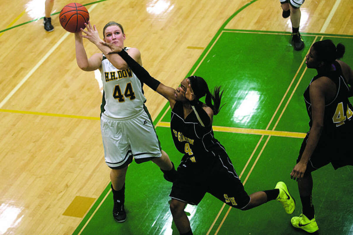 SEAN PROCTOR   sproctor@mdn.netDow's Erin O'Neil takes a shot against Saginaw's Darhonda Turner Thursday night at Dow High School. The Lady Chargers defeated the Lady Trojans 48-38.