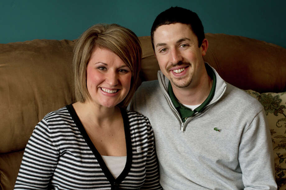 Chelsea and Tom Cronkright of Midland have been married for two years. Photo: Neil Blake/Midland  Daily News / Midland Daily News