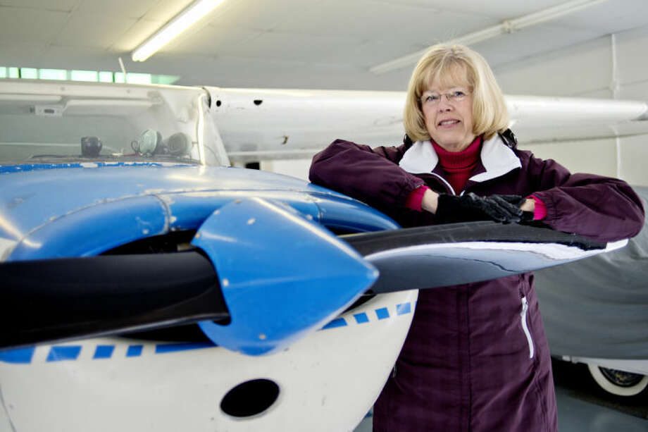 NICK KING | nking@mdn.netLinda Langrill, posing with a Cessna 172 which she uses for instructing from time to time at Jack Barstow Municipal Airport, was named Certified Flight Instructor of the Year for the Great Lakes region. Photo: Nick King/Midland  Daily News