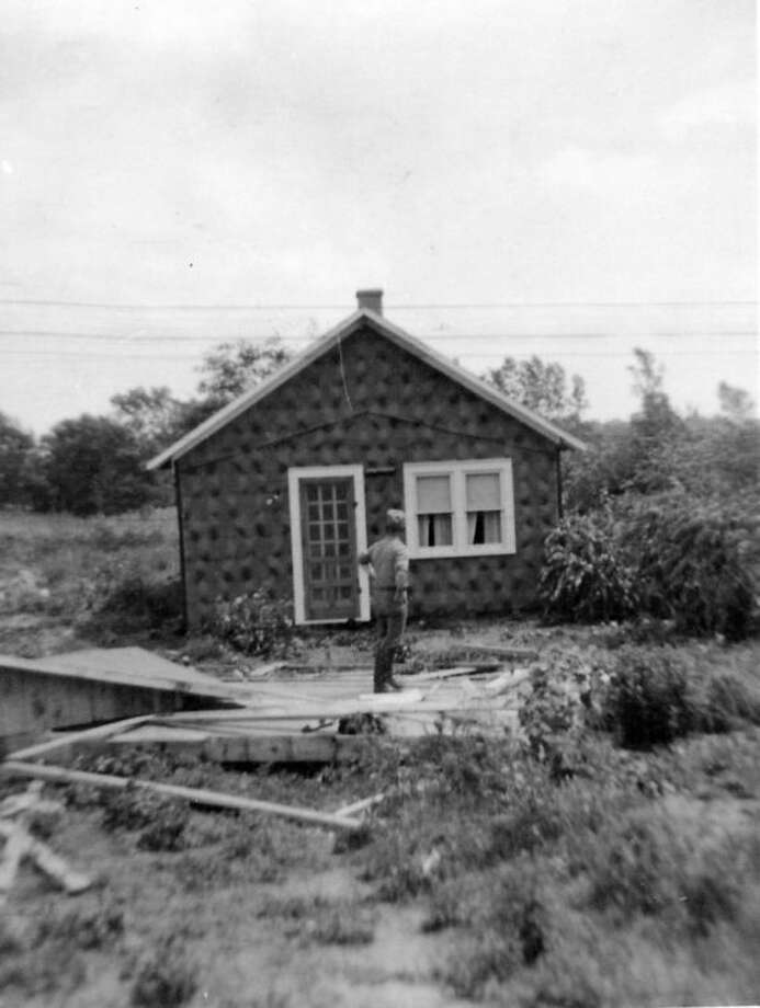 This is the little Raymond and Dora Pifher home on River Road after a tornado moved the home 15 feet off its foundation. The tornado struck without warning on Aug. 8, 1939