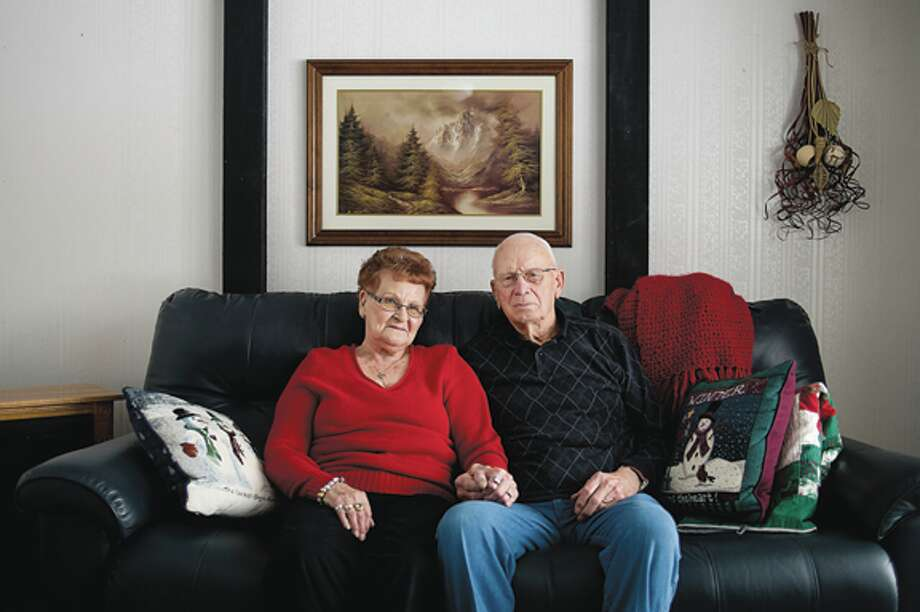 Opal and Clayton Wolfgang have been married for 65 years. They are coming up on their 66th wedding anniversary later this month. They live in a home that they built themselves on Pine River Road in Breckenridge. Photo: Neil Blake/Midland  Daily News / Midland Daily News