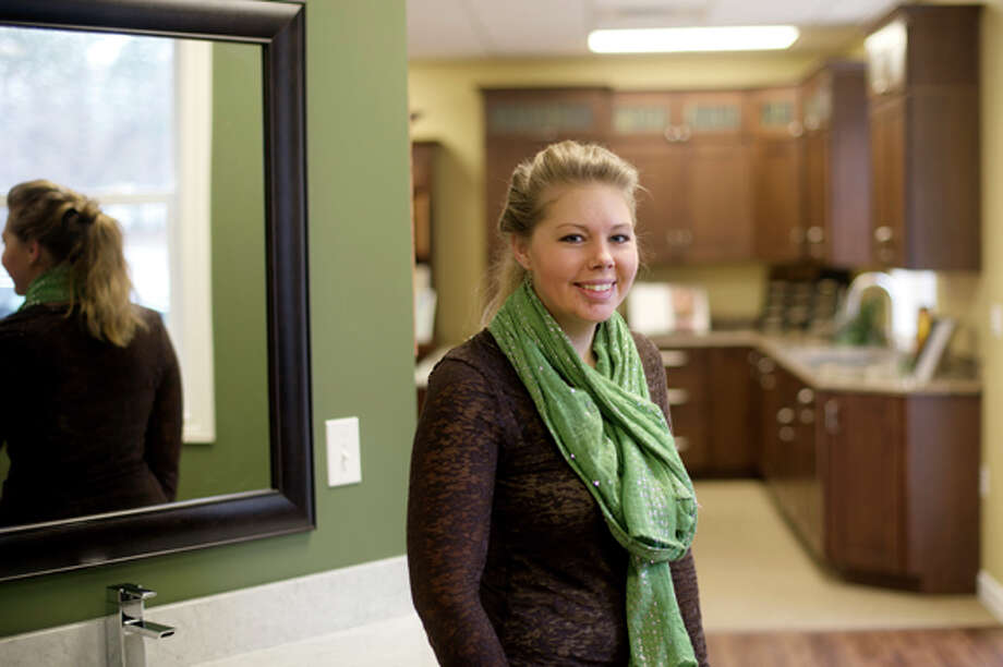 Hali Gilbert, with Nowak Cabinets, offers various solutions for your bedroom remodeling. Photo: Nick King/Midland  Daily News / Midland Daily News