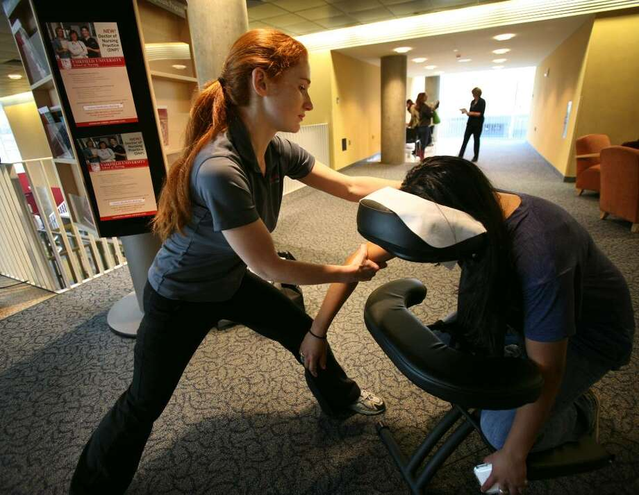 Mary Payne of Massage Envy in Fairfield gives a free massage to Fairfield University sophomore Glorivette Rodriguez, 19 of Brooklyn, NY, in the Barone Campus Center at Fairfield University on Wednesday, March 31, 2010. Students receive the massages for filling out a mental health screening form. Photo: Brian A. Pounds / Connecticut Post