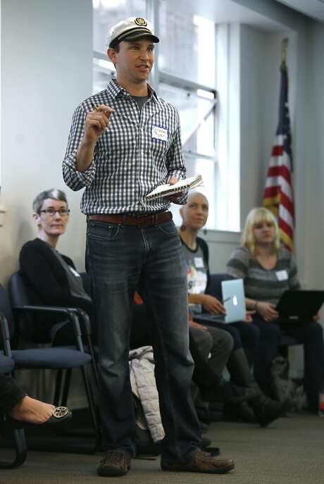 CEO Ryan Ozimek of Soapbox Engage, which builds online tools that integrate with Salesforce software, speaks at the session for nonprofit groups. Photo: Liz Hafalia, The Chronicle