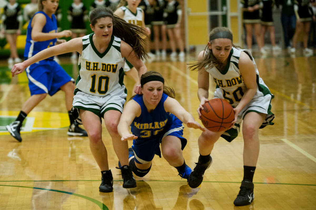 JEFFREY SMITH | for the Daily NewsMidland forward Alyssa Westphal dives for the ball as Dow guard Heather Derstine recovers it Thursday evening at H.H. Dow High School. Dow High won 58-51.