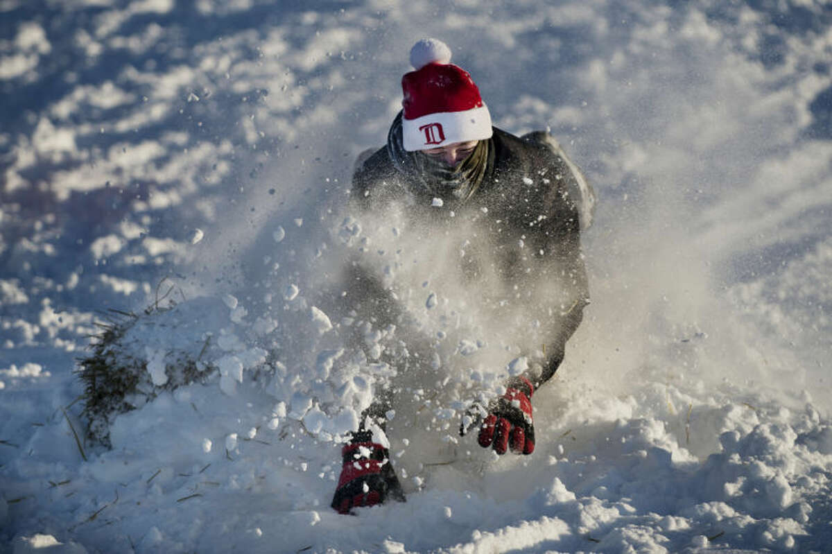 NEIL BLAKE | nblake@mdn.netZack Rueger, 17, of Auburn, sleds face first down the hill at Overlook Park in Midland on Friday. Rueger and a few friends attempted to build a jump on the hill with varying degrees of success using the powdery snow. Rueger had a snow day from Valley Lutheran High School in Saginaw.