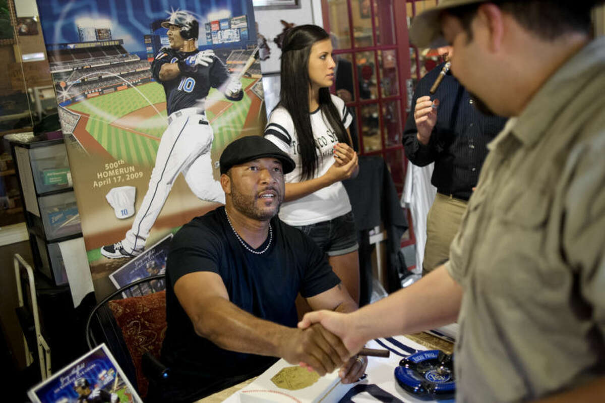 NICK KING | nking@mdn.netFormer Detroit Tigers' slugger Gary Sheffield, left, shakes hands with Michael Martin, of Bay City, at the Tobacco Shoppe on Thursday in Midland after Sheffield autographed Martin's box of HR 500 cigars. Martin said the cigars were for him and that he planned to give his father, who doesn't smoke cigars, the signed box. Sheffield signed purchased boxes of the new cigars made by the Rocky Patel company in honor of Sheffield's 500th career home run, which he hit in 2009 with the New York Mets.