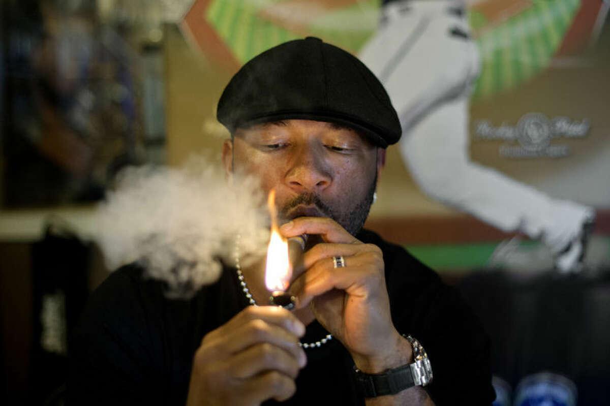 NICK KING | nking@mdn.netFormer Detroit Tigers' slugger Gary Sheffield lights his HR 500 cigar Thursday at the Tobacco Shoppe in Midland.