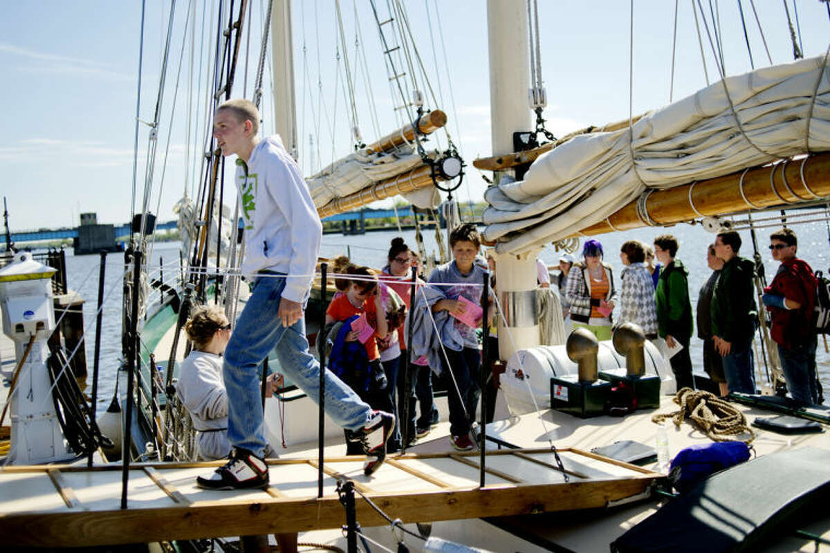 NICK KING   nking@mdn.netFarwell Middle School student Christian Kuhns, 14, exits the Appledore IV Wednesday at Wenonah Park in Bay City. This year marks the 15th anniversary of the sail ship in Bay City. The students were on board as part of an educational program offered using the ship.