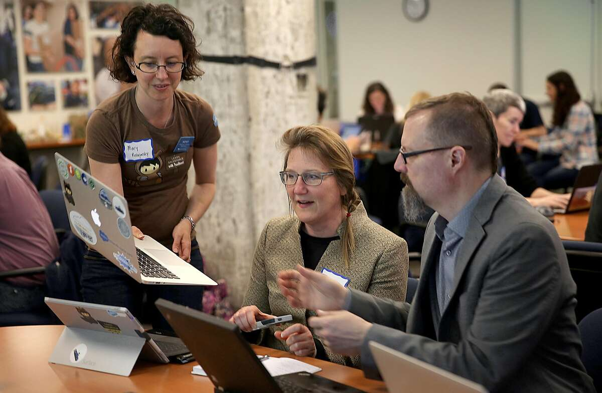 Mary Pustejovsky (left), Bonnie Hinners (middle), and Peter Bender (right) attend the Nonprofit Starter Pack Community Sprint at United Way in San Francisco, California, on monday, march 21, 2016. Salesforce gets together with nonprofits and consultants to brainstorm ideas on how improvements can be made to better meet their needs.