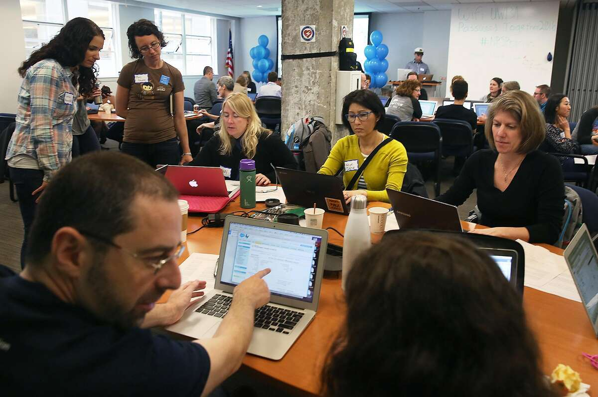 Marc Baizman (front left) salesforce.org staff attends the Nonprofit Starter Pack Community Sprint at United Way in San Francisco, California, on monday, march 21, 2016. Salesforce gets together with nonprofits to brainstorm ideas on how improvements can be made to better meet their needs.