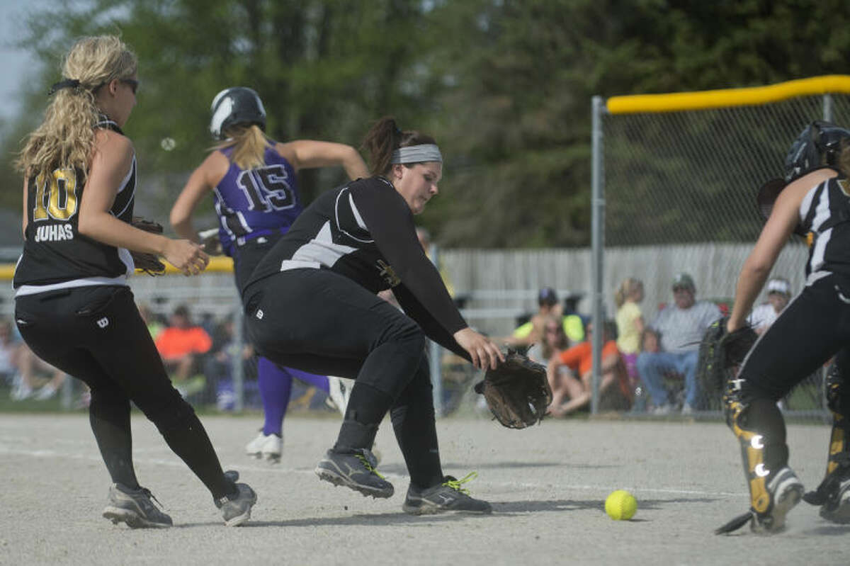 NICK KING   nking@mdn.netBullock Creek's Melissa Reed, center, fields a bunt by Swan Valley's Paige Churchfield (background) as Reed's teammates Kelcie Juhas, left, and Maison Kalina close in during the sixth inning Monday at Bullock Creek High School.