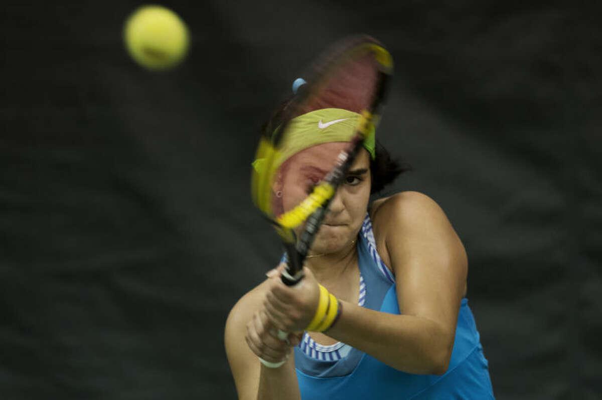 NEIL BLAKE | nblake@mdn.netNorthwood University's Susana Alcaraz returns the ball during her match against Grand Valley State University's Niki Shipman at the Midland Community Tennis Center on Tuesday. Alcaraz won 6-3, 6-2.