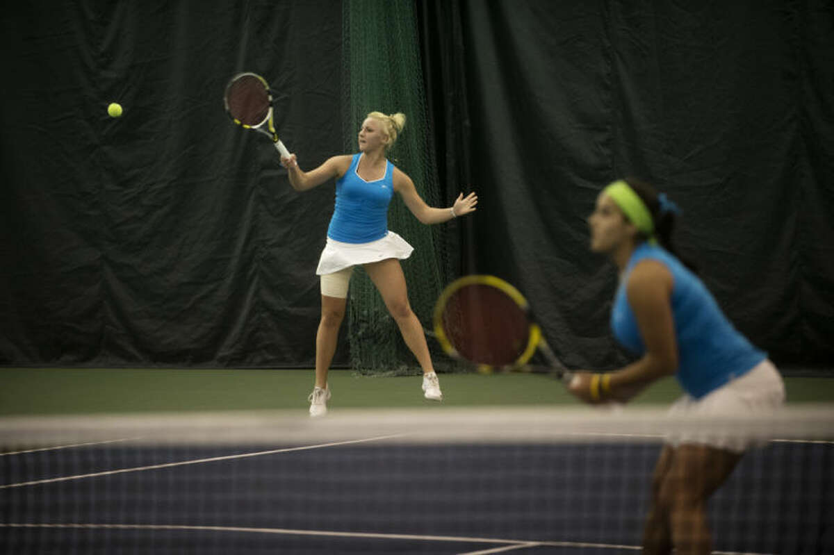 NEIL BLAKE | nblake@mdn.netNorthwood University's Nastya Puchkina hits the ball as teammate Susana Alcaraz stands at the ready during the number one doubles match against Grand Valley State University Tuesday.