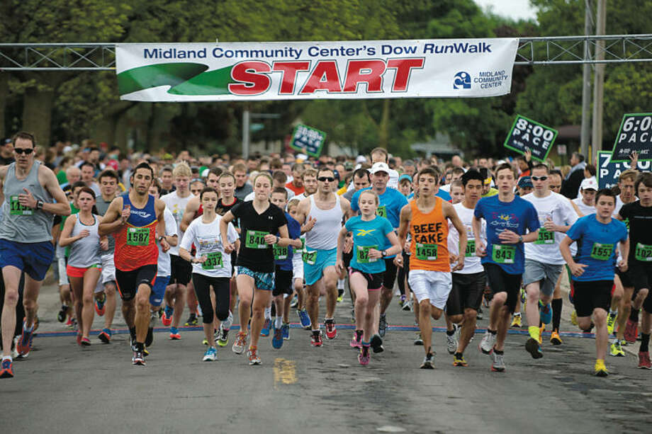 NICK KING | nking@mdn.netRunners begin the 5k race at the starting line on Collins Street Saturday during the Midland Community Center's Dow RunWalk. Photo: Nick King/Midland  Daily News