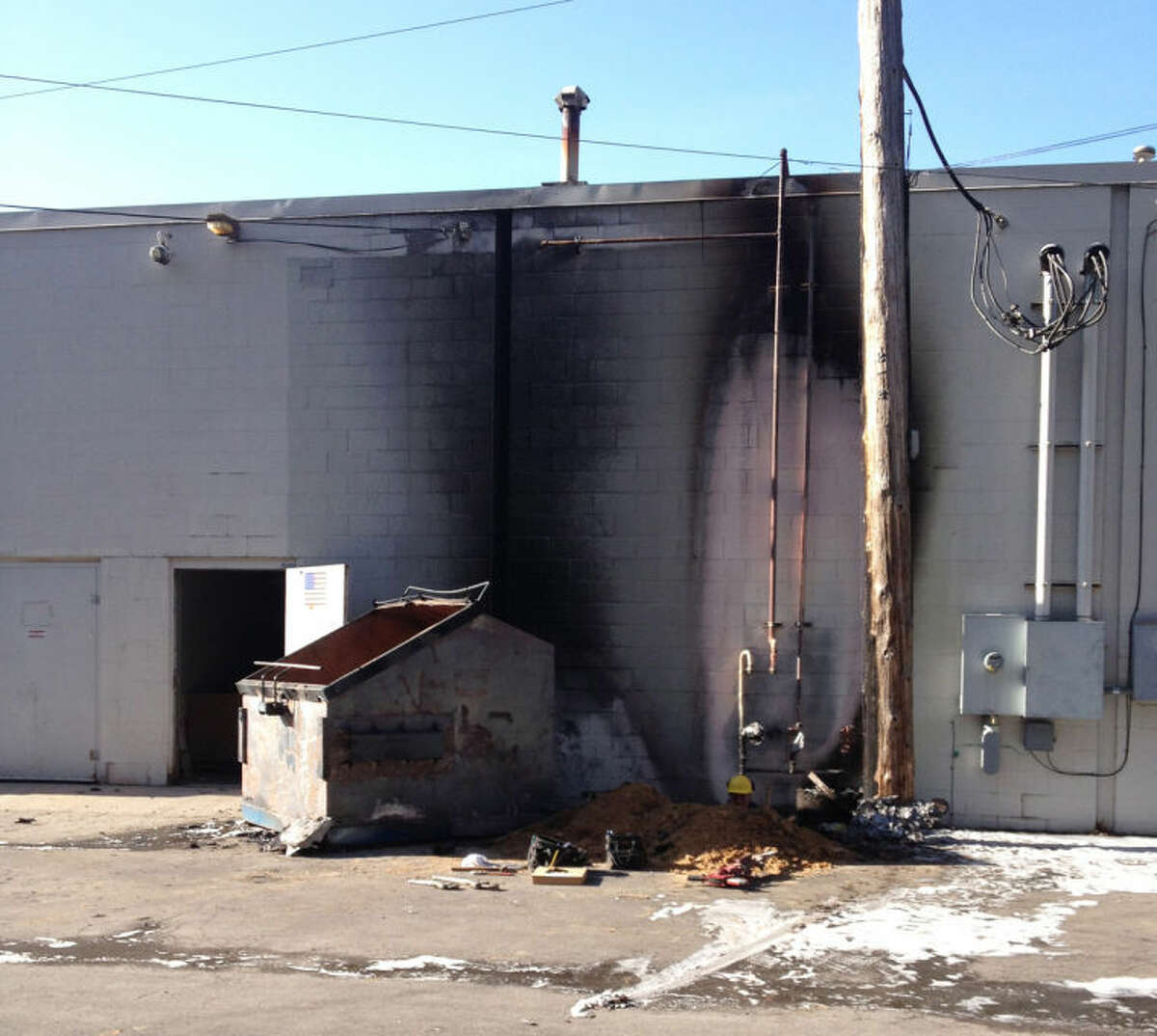Kelly Dame   kdame@mdn.netBurn marks can be seen on the Family Fare building this morning after a fire in the trash bin.